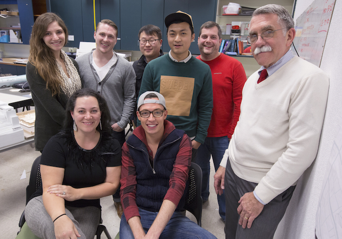 "The designers of the ""In Harm's Way"" project: Back row (from left to right): Miranda Spears, Alex Ausenhus, Yongyeon Cho, Zhenru Zhang, Nathan Thiese. Front row: Maricel Lloyd, Josh Kassing, Lee Cagley. Photo by Christopher Gannon."