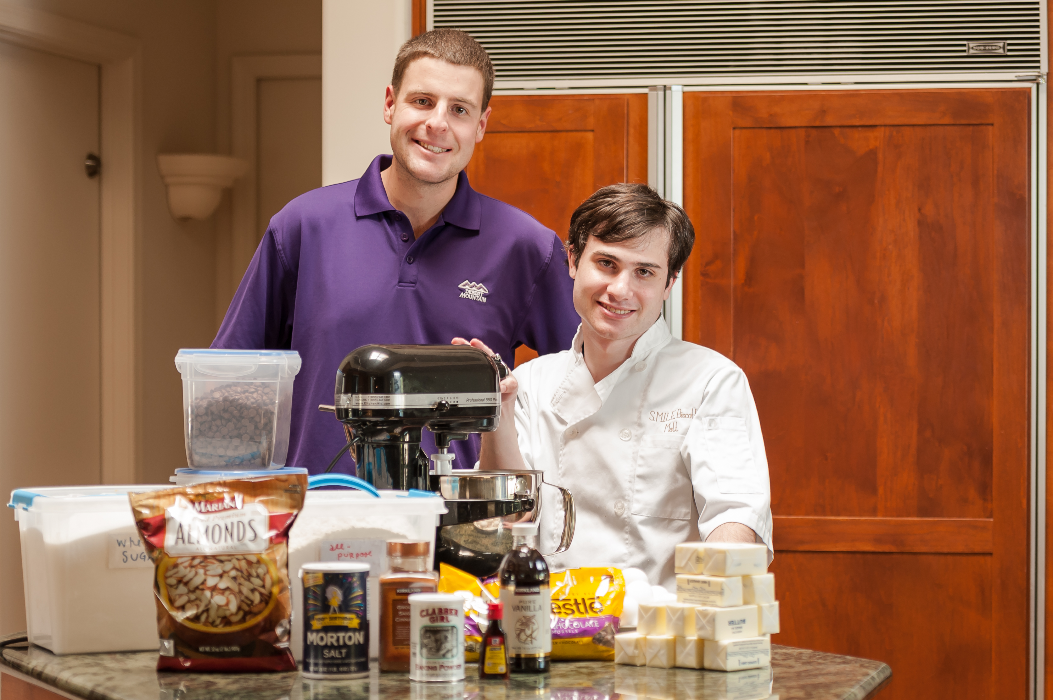 Matt (right) along with one of SMILE's other biscotti bakers