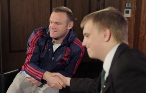 Wayne Rooney (left) and James King (right) pose for a photo.