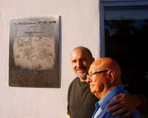Dr. Hackie Reitman (left) stands with Angelo Dundee (right) next to a plaque honoring the 5th Street Gym