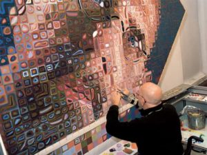Chuck Close painting a self portrait
