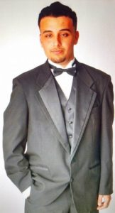 Image of Michael Posing in a Tuxedo